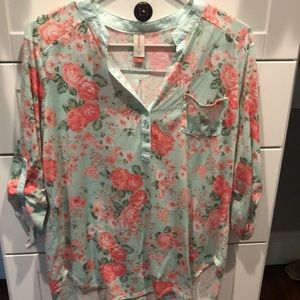 Flowered top and buttons a portion in the front